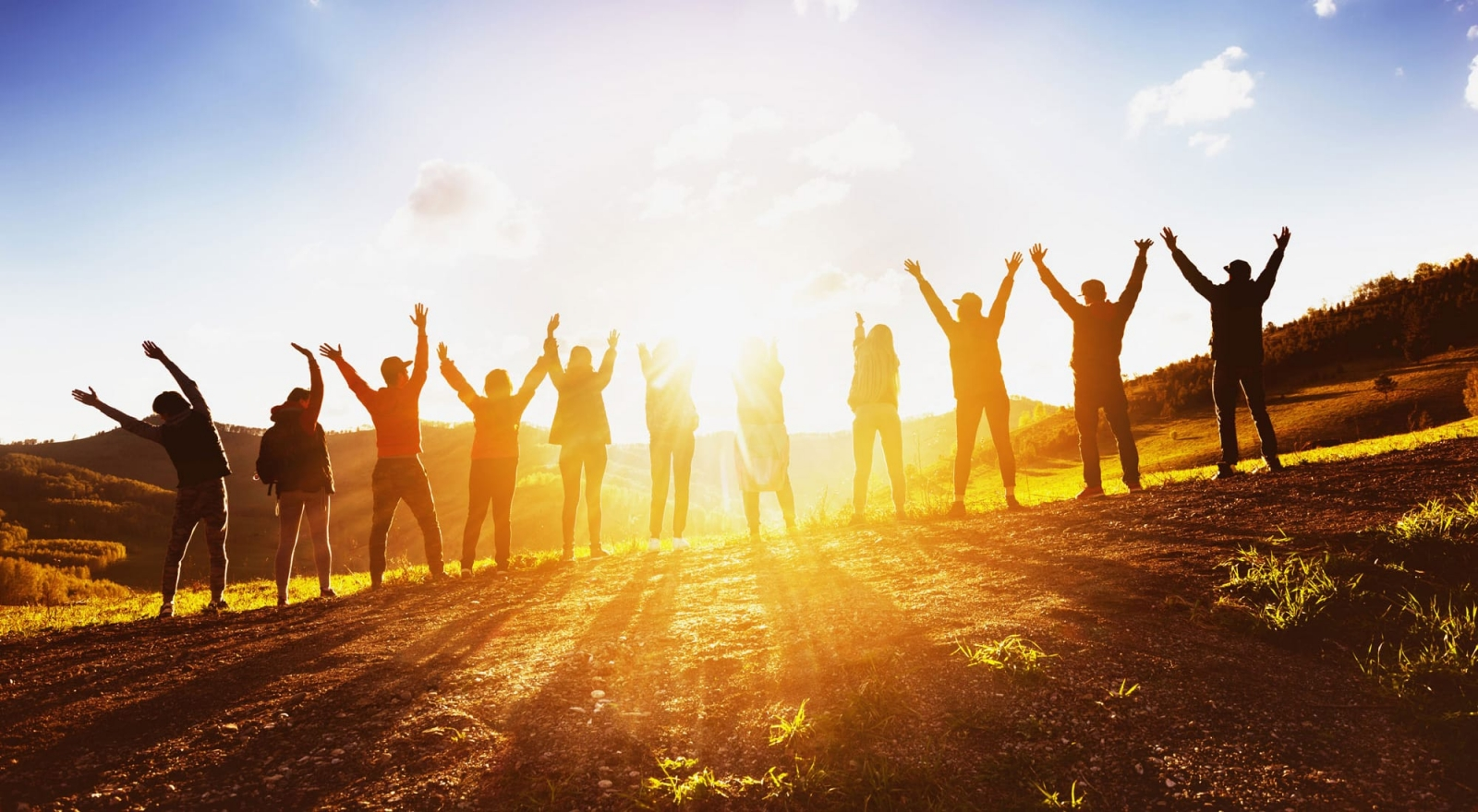 group-raise-hands-to-the-sun