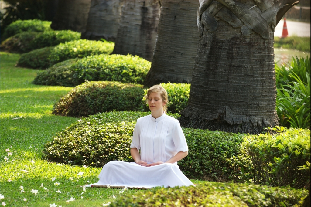 woman meditating in a park